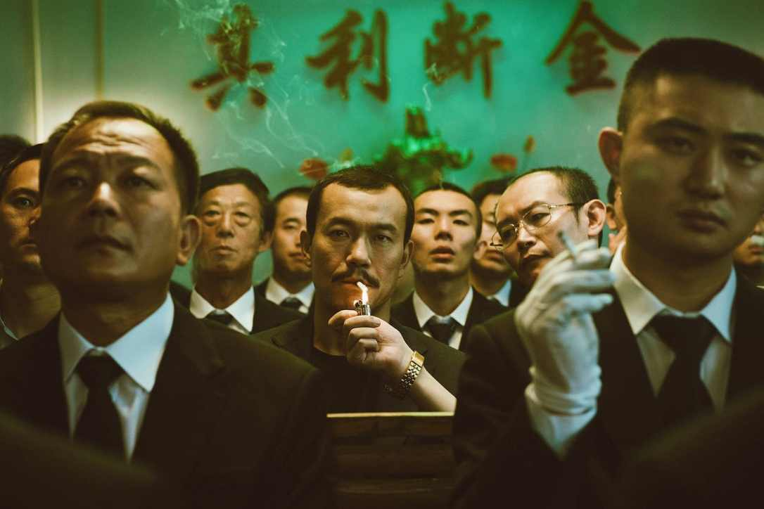 "Liao Fan, center, with cigarette, plays a mobster in ""Ash Is Purest White."""